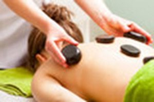 Hot Stones applied to a woman's back for a Hot Stone Massage