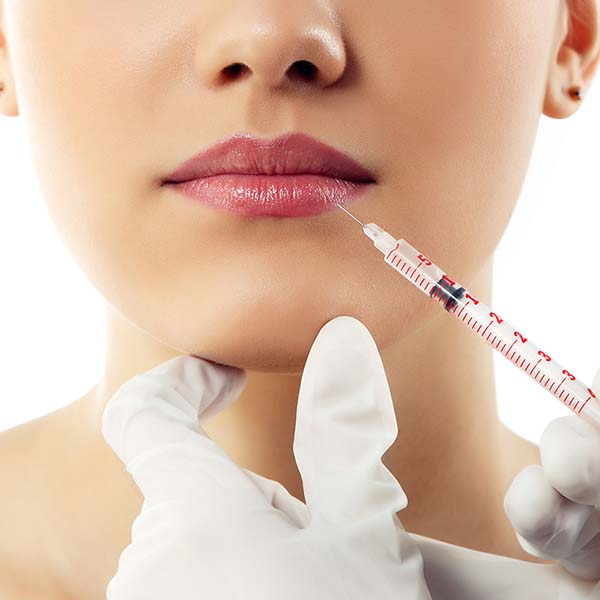 Woman's lips about to recieve an injectable filler