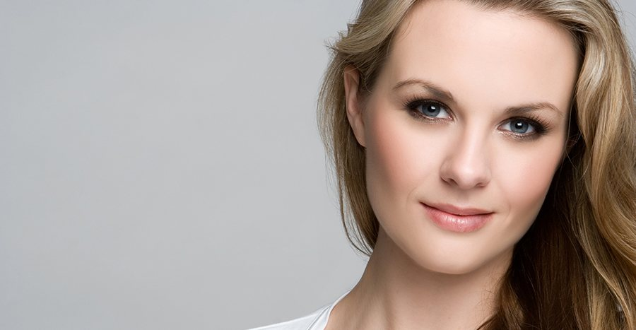 Close up of a fair-skinned blonde woman with perfectly smooth skin