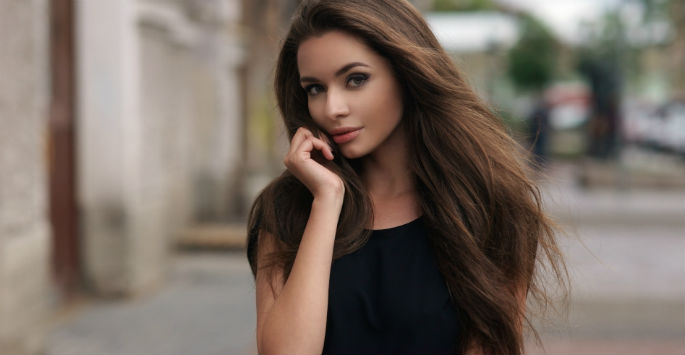 Beautiful brown-haired model enhances her beauty with BOTOX