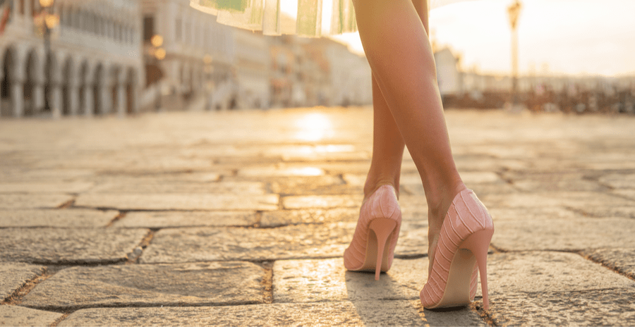 Close-up of a pair of female feet in high-heeled pink pumps