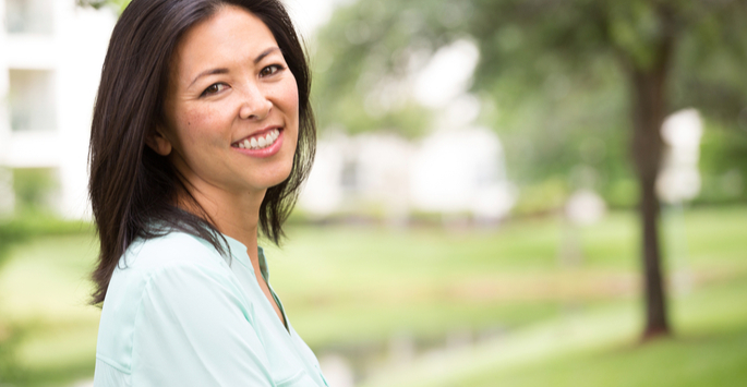 Close-up of an Asian woman in a park